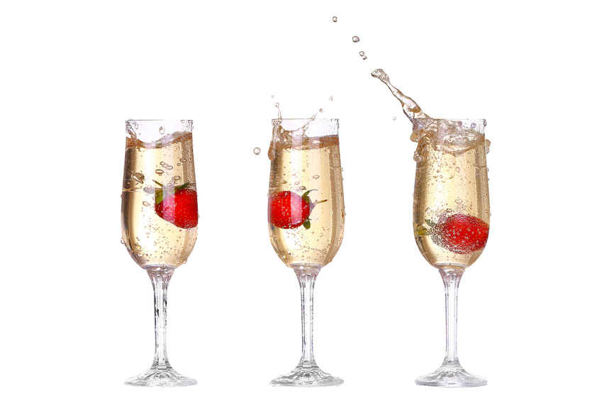 collage Single Strawberry splashing into a glass of champagne